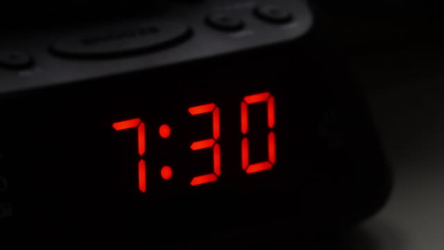 Digital alarm clock, time fro 7.29 to 7.30.