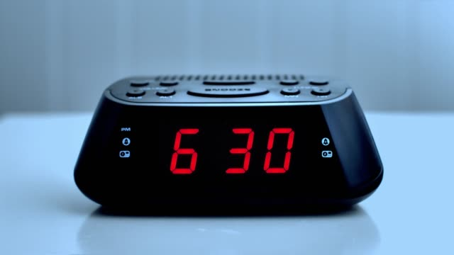 digital alarm clock, time from 6.29 to 6.30. - digital clock stock videos & royalty-free footage
