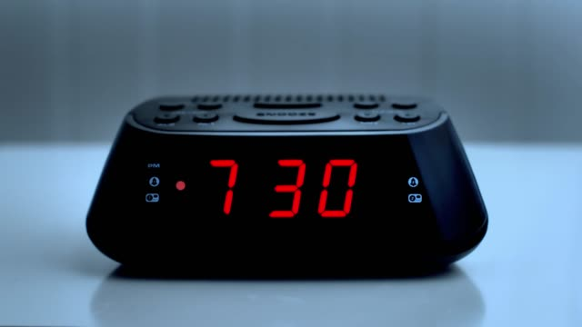 digital alarm clock, time from 7.29 to 7.30. - changing clock stock videos and b-roll footage