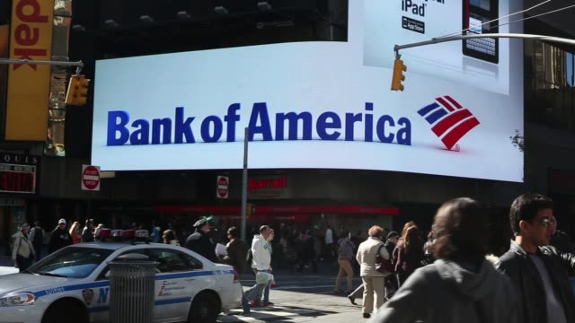 pan of digital bank of america billboard in times sqaure / crowded times square / fall weather / nyc tourists bank of america billboard in times... - bank of america stock videos & royalty-free footage