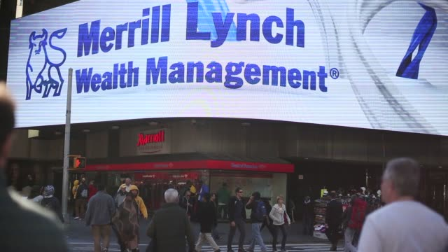 digital billboard in times square / bank of america and merrill lynch wealth management / fall weather / nyc tourists bank of america merrill lynch... - bank of america stock videos & royalty-free footage