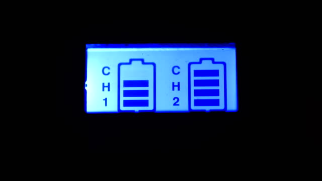 digital camera battery charger - lithium ion battery stock videos & royalty-free footage