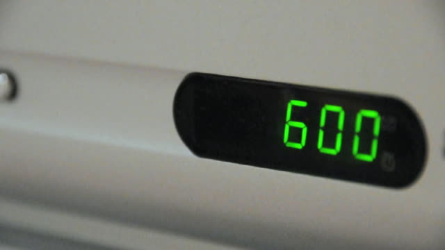 CU R/F Digital clock showing 6 o'clock, Amsterdam, Netherlands