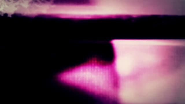 stockvideo's en b-roll-footage met a digital data curtain, burned film and grungy sprocket holes. - sprocket