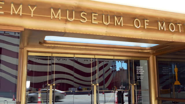 los angeles, california, usa - september 13, 2021: digital display and main entrance to the academy museum of motion pictures on wilshire boulevard (miracle mile) in los angeles, california, 4k - academy of motion picture arts and sciences stock videos & royalty-free footage