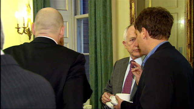 downing street meeting england london 10 downing street int television and digital industry executives stand chatting informally in room including... - downing street stock-videos und b-roll-filmmaterial