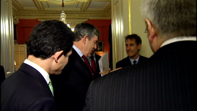 downing street meeting gordon brown mp stands chatting with unidentified executives lord carter stands alongside him/ good shots of gordon brown... - downing street stock-videos und b-roll-filmmaterial
