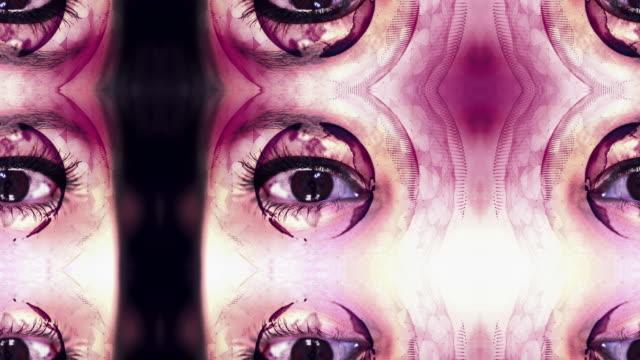 digital globe rotating around close up eye - 3d human face stock videos & royalty-free footage