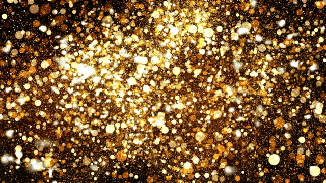 digital golden sparkling dust texture - glowing stock videos & royalty-free footage