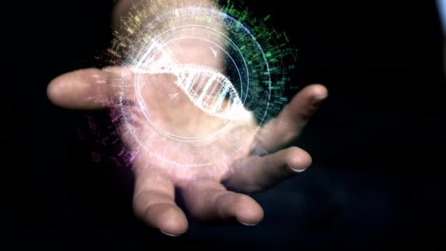 digitalen helix in der hand. dna-gestaltung - dna stock-videos und b-roll-filmmaterial