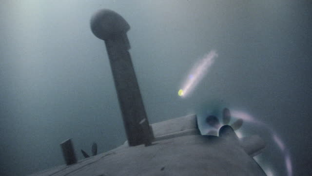 a digital image shows a torpedo speeding towards a submarine. - torpedo stock videos & royalty-free footage