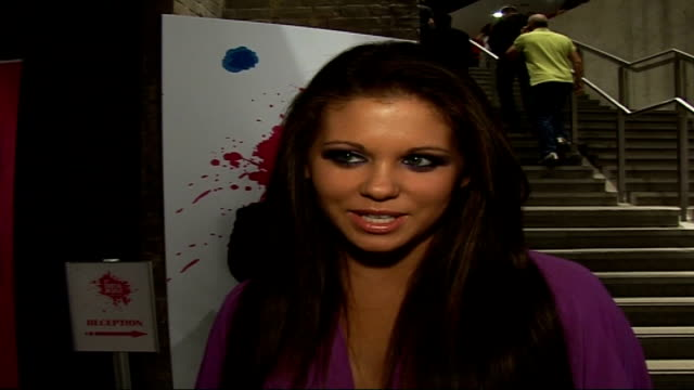celebrity photocalls and interviews bianca gascoigne wearing purple lowcut dress posing for photocall / bianca gascoigne interview sot on her fashion... - 胴体点の映像素材/bロール
