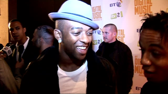 celebrity photocalls and interviews Members of boy band JLS posing for photocall Oritse Williams and Aston Merrygold interviewed SOT Can they win...