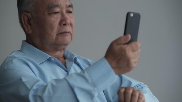 digital photos are useful, when i am sad. - senior men stock videos & royalty-free footage
