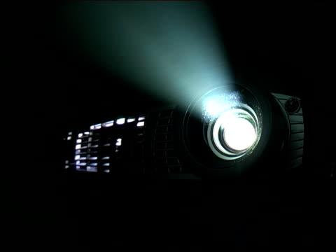 digital projector with smokey light beam - projection equipment stock videos & royalty-free footage