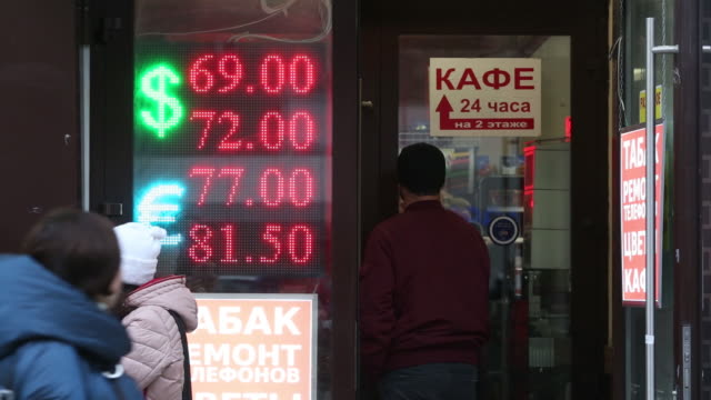 a digital screen displays foreign exchange rates above an exchange bureau in moscow russia on tuesday march 10 2020 the bank of russia readied its... - 整理ダンス点の映像素材/bロール