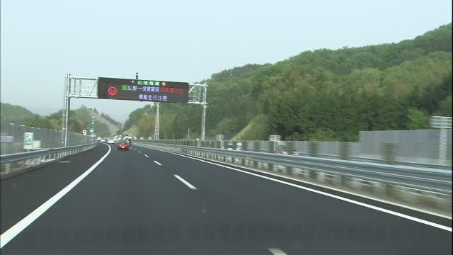 digital signs provide traffic information on the kita-kanto expressway. - digital signage stock videos and b-roll footage