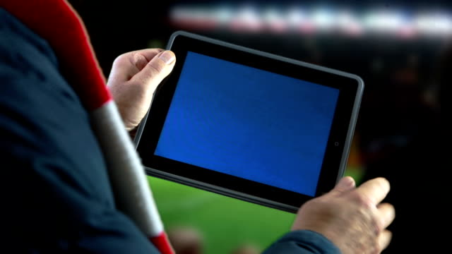 Digital tablet at the game.