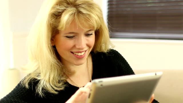Digital tablet girl at home close.