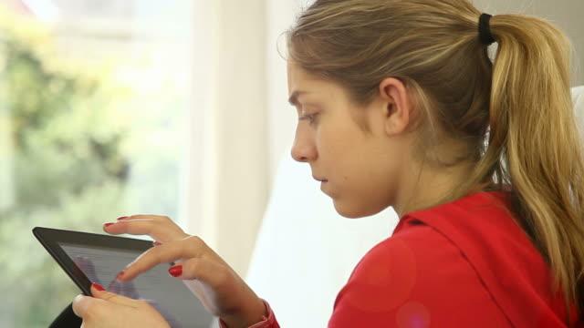 Digital tablet girl at home.