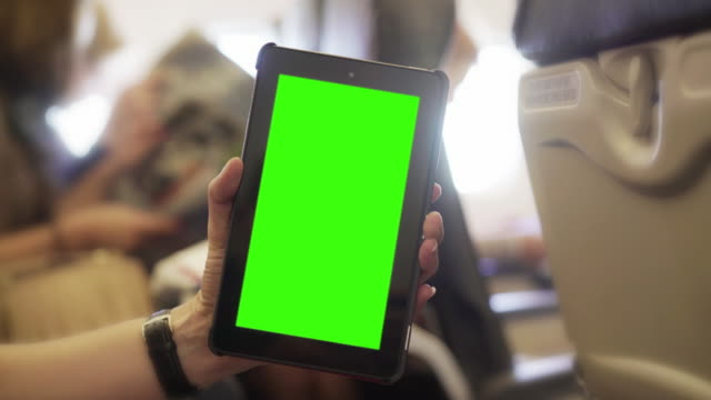 Digital tablet on a plane. Chromakey.