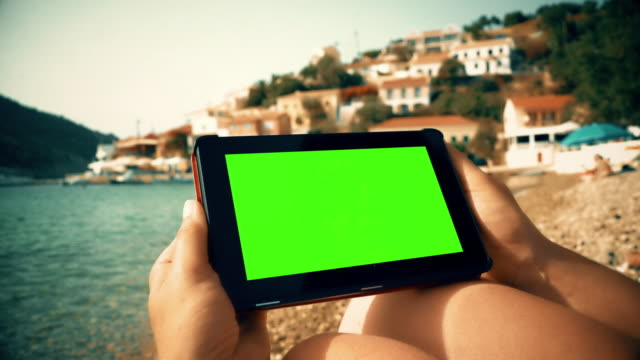 Digital tablet on the beach, Chromakey.