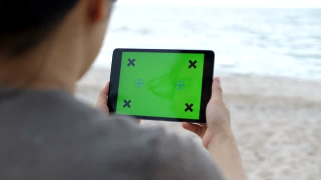 digital tablet on the beach - surfing the net stock videos & royalty-free footage