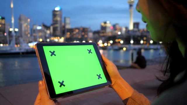 digital tablet on the night city auckland pier - new zealand stock videos & royalty-free footage