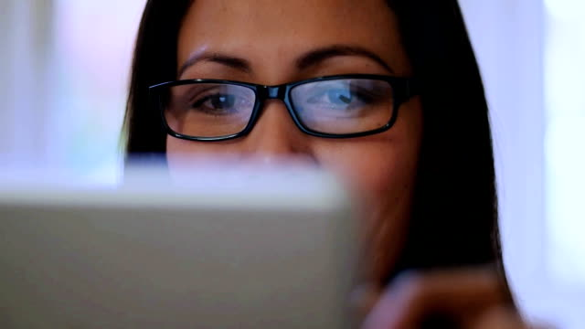 digital tablet, reflection. se asian woman. - using digital tablet stock videos & royalty-free footage