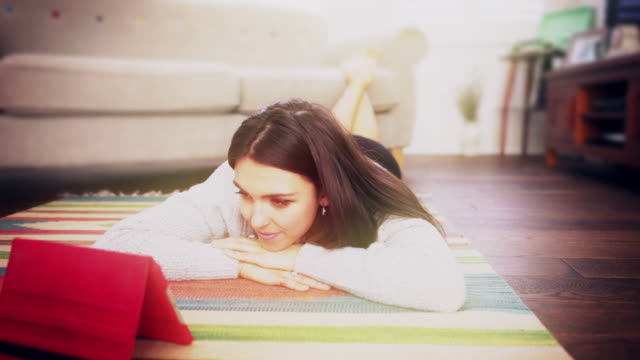 digital tablet, watching tv. young woman. - feet up stock videos & royalty-free footage