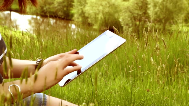 digital tablet woman, outdoors in beautiful location. - bandwidth stock videos & royalty-free footage