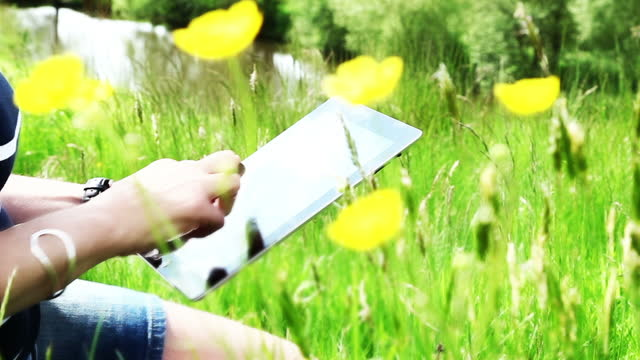 Digital tablet woman, outdoors in beautiful location