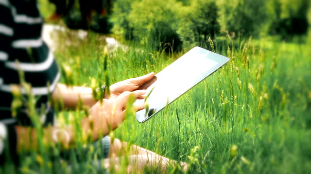Digital tablet woman, outdoors in beautiful location.