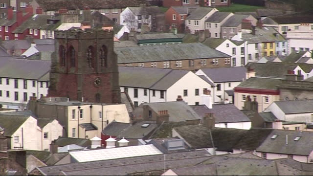 digital television due to become obligatory for residents of whitehaven england cumbria whitehaven ext general views of town old age pensioner away... - cumbria stock-videos und b-roll-filmmaterial