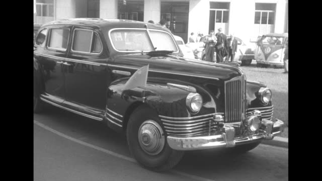 cu dignitaries cars parked in row / cu russian flag on hood of limo / chinese flag on front fender of limo / cu chinese flag on fender / chauffeur... - 1954 stock videos & royalty-free footage