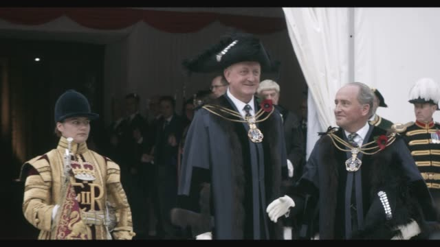 dignitaries come out of the guildhall 'silent ceremony' where peter estlin has been inaugurated 691st lord mayor of the city of london he will... - lord mayor of london city of london stock videos & royalty-free footage