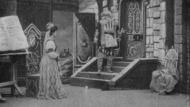 1901 B/W Dignitary leaving on journey and giving wife key to locked room, which she opens and enters after urging from the jester