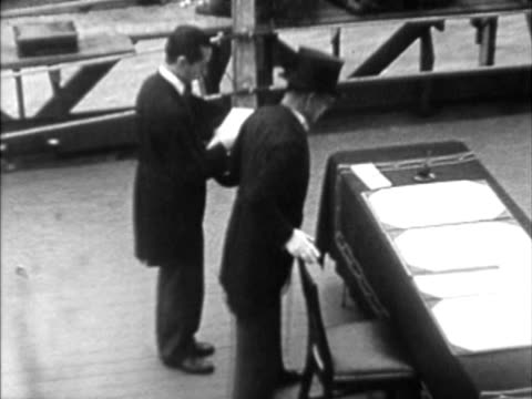 W HA COMPOSITE Dignitary signing treaty on table on board of naval vessel during Japanese surrender