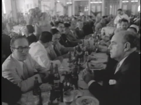 dignitary sits at the head table of an officers' club function in cam ranh, south vietnam. - south vietnam stock videos & royalty-free footage