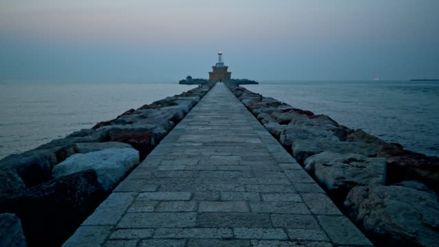 Dike and lighthouse at dawn, Punta Sabbioni, Venice, Venetian Lagoon, Mediterranean Sea, Veneto, Italy