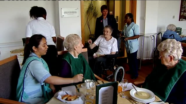 health secretary says government would struggle to pay england int general view of nurses and elderly people in care home elderly woman eating soup... - dining room stock videos & royalty-free footage