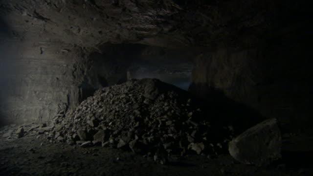 dim light illuminates a mining tunnel. - drill stock videos & royalty-free footage