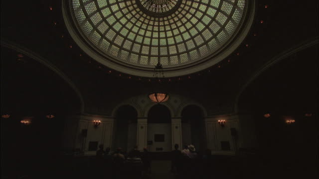 Dim light shines through a domed skylight.
