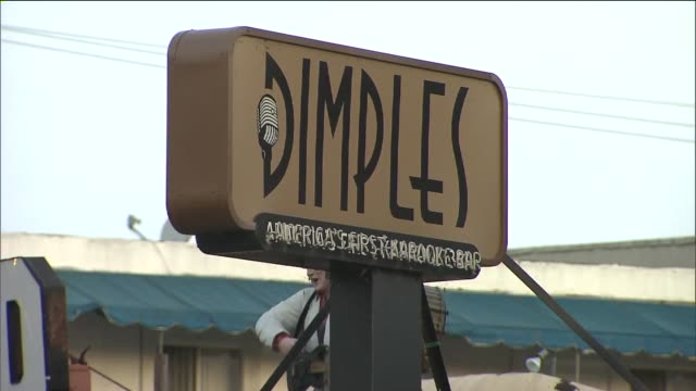 ktla dimples karaoke bar in burbank dimples has billed itself as america's first karaoke bar since opening in 1982 now this burbank staple shut down... - dimple stock videos and b-roll footage