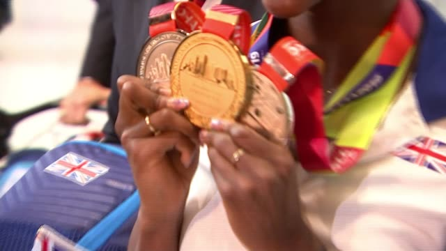 dina asher smith returns from doha after 200m gold triumph; england: london: heathrow airport: int **some flash photography** dina asher-smith... - gold stock videos & royalty-free footage