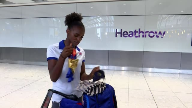 Dina AsherSmith returns after winning three gold medals at the European Championships ENGLAND London Heathrow Airport INT Various of Great Britain...