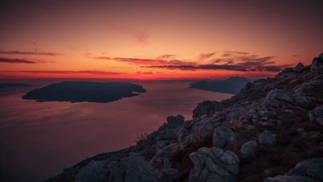dinaric coastline, brac island under a sunset, biokovo, croatia - ブラック島点の映像素材/bロール