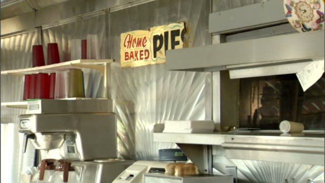diner wall cups upside down on shelf over partial coffee machine pots of frame home baked pies poster partial kitchen window cash register toast... - poster frame stock videos & royalty-free footage