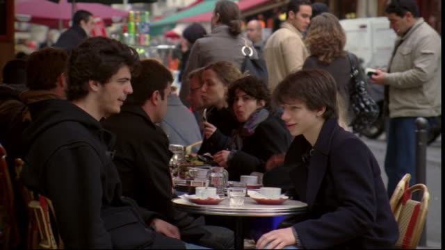 diners eat at an outdoor cafe in paris, france. - ile de france stock videos and b-roll footage