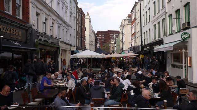 diners gather outside in old compton street, soho as restaurants cater for outdoor dinning as lockdown restricting ease on april 27, 2021 in london,... - outdoors stock videos & royalty-free footage